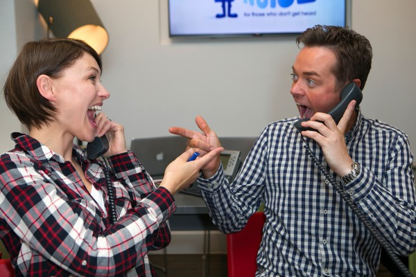 Global's Make Some Noise Charity Day. Stephen Mulhern and Emma Willis, poses for a picture at the 'phone room' to support Global's Make Some Noise at Global studios in Leicester Square, London. Global's Make Some Noise is a national charity that raises money to help disadvantaged youngsters and gives voice to small projects and charities across the UK that struggle to raise awareness.